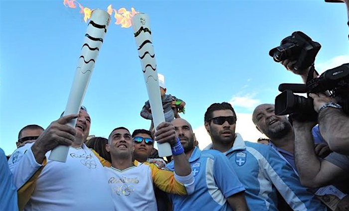 Disabled Syrian Refugee Carries Olympic Torch in Greece